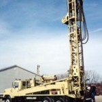 Rotary drill and truck